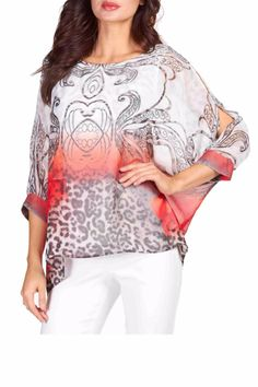 Lined free-flowing top with bat wing sleeves in a white red and beige print over an off white camisole. Perfect for spring and summer the colors will carry over for fall wear as well. Batwing Layered Top by Frank Lyman. Clothing - Tops - Casual British Columbia Canada