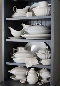 grey shelves white china
