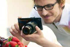 Sony's rumored QX10 and QX100 'lens cameras' pair with your smartphone or tablet, pictured ahead of release