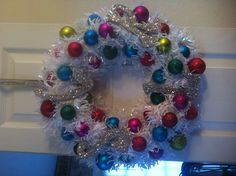 Christmas Wreath for the Dorm Door but use burlap and maroon/white ornaments