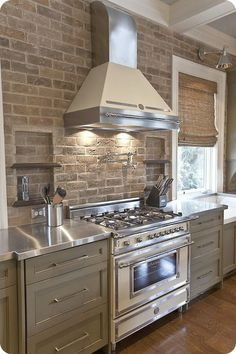 Kitchen. Love the openness on both sides of the hood