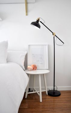 Ikea lamp and side table with an all white room. Check out how we made this room over on a budget.