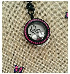 Medium locket with the new fuchsia face from Origami Owl. Visit my site: https://dreambig.origamiowl.com/  #lockets #charms #onceuponatime #newcharms #charming #clocks #alarmclock #butterfly #swarovski #crystals #jewelry #fashion #fashionista #giftsforher #Origami #owl
