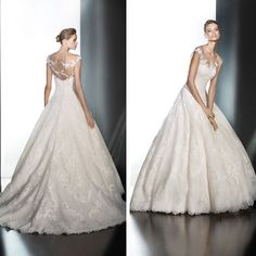 Presen by Pronovias - A really beautiful ballgown with mixed-types of lace~ these pictures do not do this gown justice!  In-store in Off-White, size 12.  #eogowns  #bridalgown  #pronovias  #illusionlace  #ballgown  #weddingdress  #bridetobe