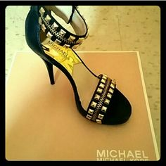 Limited Edition Michael Kors gold studded pumps Limited Edition NWOT. Gorgeous black and gold pumps. Brand new in box! Never worn. Perfect Christmas gift and beautiful for New Years Eve!!! Make an offer! PRICE NEGOTIABLE  MICHAEL Michael Kors Shoes Heels