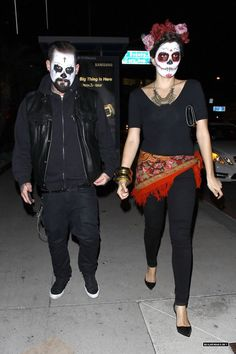 Benji Madden and a mystery girl arrive for a Halloween party at Bootsy Bellows (Oct 26, 2013) Note: the woman isn't such a mystery girl, she belongs to Benji's good friend David Katzenberg - the other guy in the photo with Benji and Joel.