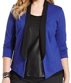 Plus Size Tuxedo Blazer  Tuxedo blazers are a common trend right now, and this amazing cobalt blue is another.  We are loving contrasting lapels and strong silhouettes.   A blazer like this makes it easy to dress up an outfit.  Pair with a simple V-Neck and your favorite dark denim for a simple and chic look.