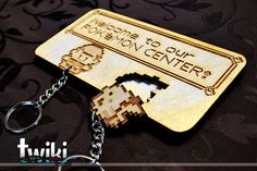 Laser cut and engraved Pokémon Center wall key di TwikiConcept