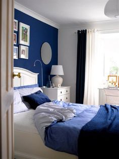 Blue Bedroom-just one blue wall with blue bedding and black accents and white bed