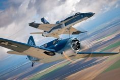 """To commemorate the 100th Anniversary of Naval Aviation, an F/A-18C Hornet takes on the colors of a WWII Helldiver unit and joins the world's only airworthy Helldiver in the skies above Central California. The F/A-18C is flown by VFA-122's LT Alex """"Scribe"""" Armatas and the Helldiver is piloted by Mark Allen"""