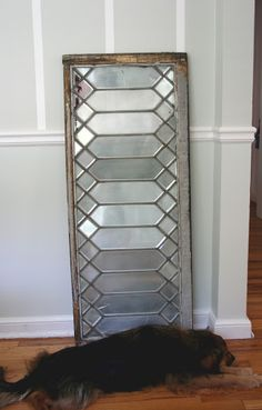 Turn an old leaded glass window into a vintage mirror with Krylon Looking Glass paint. http://www.ecabonline.com/2010/11/diy-mirror-from-leaded-glass-window.html