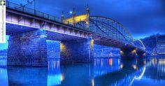 Pittsburgh Pennsylvania, Smithfield Street Bridge reflected in the Mongohela River.  Photo by Glen Green