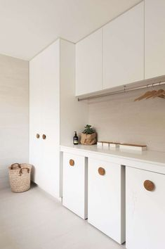 Design Idea – Oversized Wood Knobs On Cabinets - This modern house features oversized natural wood door handles on all of the cabinets throughout th - Wood Door Handle, Utility Room Designs, Upside Down House, Ceiling Storage, Laundry Room Cabinets, Kitchen Cabinets, Storage Cabinets, Cupboards, Laundry Room Inspiration