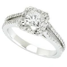 14K white gold split shank princess cut angel's halo diamond semi-mount ring. This elegant ring features two rows of H/SI pave set diamonds, meeting at a halo around the center diamond. The total weig