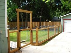 wood and welded wire fence- lightens up the look yet still keeps your dog in the yard
