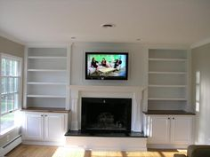 Fireplace, TV, and Bookshelves w/ cupboards