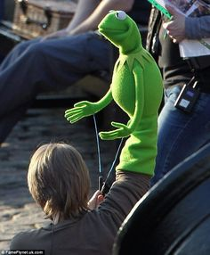 Kermit -hands operating with clear plastic sticks may potentially work with tentacles (movement)