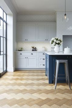 Those floors are to die for! Love this blue kitchen by Blakes London