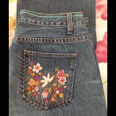 """💥SALE💥GAP Low Rise Boot Cut GAP  did this medium wash low rise boot cut just right, with embroidery and turquoise chain stitch that encircles the waist. True jean styling. Back pocket field flower embroidery and front pocket beautiful single fleur. A hint of factory distress at pocket. Inseam 31.5"""". Never altered. Waist 30"""". Excellent condition. See extra pic for bottom hem detail. GAP Jeans"""