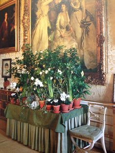 Chatsworth sitting room, love the lilies on the table and in the painting.