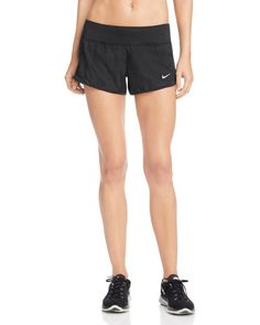 Perfect for running on the treadmill or errands in town, these comfy-cool shorts from Nike feature side stretch panels for natural range of motion and built-in briefs for support. | Polyester; waistba
