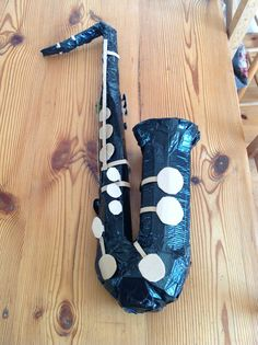 A saxophone made from cardboard and duct tape.