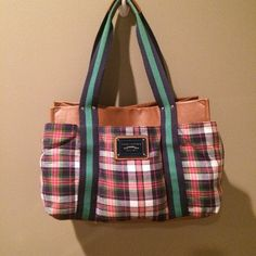 "Plaid Tommy Hilfiger Tote Pretty plaid tote by Tommy Hilfiger.  EUC.  Double strap.  Magnetic snap closure.  Front, rear and side pockets.  Interior has a zippered pocket.   9"" strap drop.  Imitation leather.  Light piling.  13x6.5x9.  Great bag! Tommy Hilfiger Bags Totes"