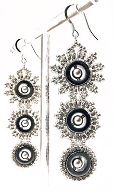Sparkling silver earrings in glass beads with Swarovski pearls and haematite. Stunning and stylish statement earrings for day and evening wear.  Size : 7cm x 2.5cm on silver hooks.  Price : £75  #DaniCromptonDesigns www.dani-c.co.uk