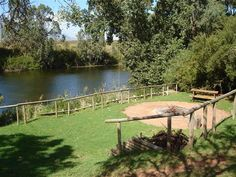 Breede Escape accommodation near Bonnievale, Western Cape. AZulu camp on the Breede River is one way to describe this excellent group getaway, comprising two separate River Camps with mini reed-and-thatch rondawels and a lapa.
