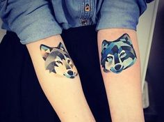 Love the placement for these wolf head tattoos