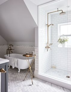 Browse beautiful modern and traditional bathrooms with stunning shower ideas for your next reno. #interiordesign