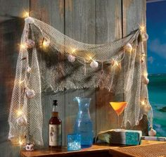 BAR is open..for over outside home bar (?)Glimmering-Nautical-Sea-Shell-Light-set-with-Fish-net-Tropical-Bar-Party-Decor