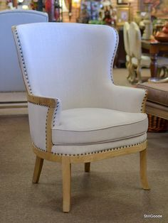 Pair of deconstructed wingback style club chairs with bleached wood frames, linen tone upholstery.  Brand new on consignment by designer.