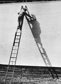 I like the shadow of the guy on the ladder and the black and white effect given
