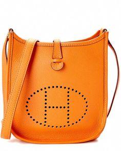 4dba4b79790 Hermes Orange Clemence Leather Evelyne I TPM is on Rue. Shop it now.