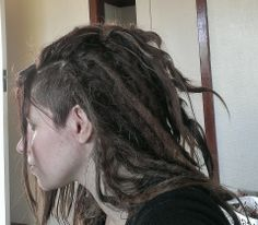 Side cut and dreadlocks.