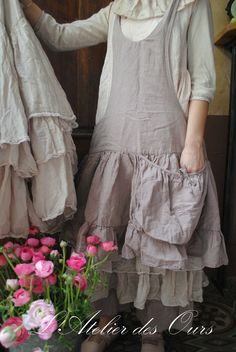 Linen apron over long, flouncy skirt with flouncy collar on top and a wonderfully huge pocket on the apron. Very romantic and feminine. ~