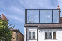 Modern loft extension with ebony stained larch cladding and black aluminium glazing system Ranch House Plans, Craftsman House Plans, Home Design, House Front Gate, Architectural Technician, Larch Cladding, Attic Conversion, Loft Conversions, Dormer Windows