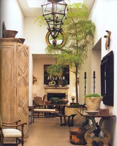 If I ever get me very tall ceilings, I am going to put a tree in my house. Bohemian Living Rooms, Living Room Decor, Beautiful Interiors, Beautiful Homes, Interior Architecture, Interior And Exterior, Escalier Design, Hacienda Style, Tall Ceilings