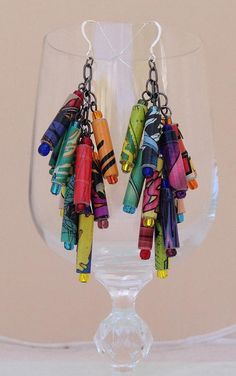 Colorful paper bead dangle earrings made from comic books. $25. Link goes to Etsy. Pinned by CraftsCrazy.
