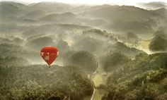 Ride in a hot air balloon anywhere...either mountains, ocean or during the migrations in africa