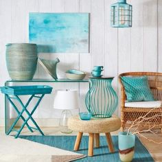 From tabletop pieces to cushy blankets and throw pillows, turquoise accents are the perfect way to up your coastal quotient.
