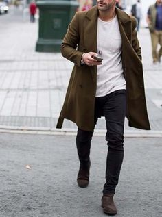 Clean white tee, black skinnies and boots, topped off with a long coat or a cardy
