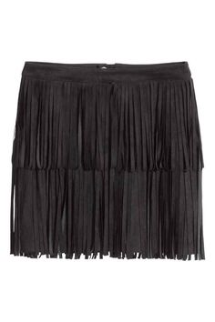 Skirt with fringes: Short skirt in imitation suede with fringes and a visible zip at the back. Unlined.