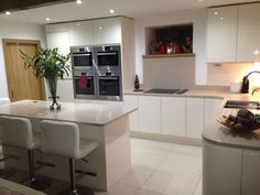 Clients Cream Handless kitchen in Chorley, with curved units and Bosch appliance's.