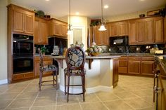 Natural wood cabinetry and an eat-in counter creates a warm and inviting kitchen.