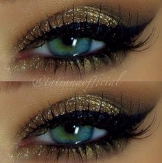 Gold eye shadow and black liner