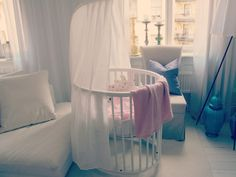 My dream nursery (I know, me having a dream nursery is ironic consiering my voisterous opionion of never having children. but i do anyways!) but my dream nursery has a rounded crib.. much like this one- but it is bigger ( not adult size or anything) and is placed right in the middle of a very brightly lit room where sunlight streams in every window... lovely
