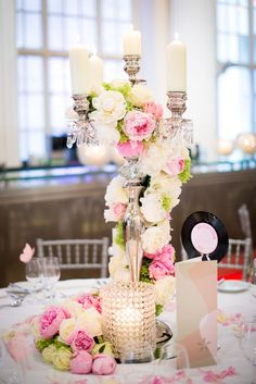 Silver candelabra decorated with white & pink peony from Louise & Tim's Wedding Day #mylondonweddingplanner