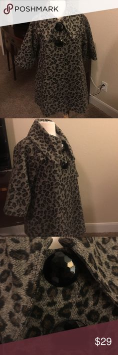 """Leopard 3/4 sleeve swing jacket lightweight This cute jacket is in a leopard print with two large buttons at the top It is three-quarter sleeve and  is """"A"""" line or swing style. It is lightweight and lined. Could be worn as a maternity jacket, as well. But it on vacation in a boutique. Jackets & Coats Blazers"""